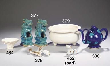 A pair of turquoise-glazed til