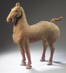 A red pottery model of a horse