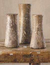 A BACTRIAN RED MARBLE COLUMN I
