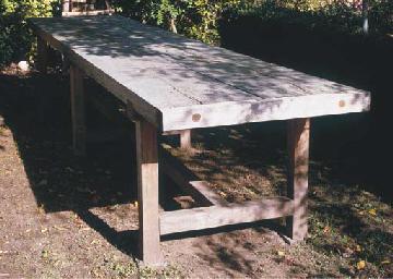AN OAK DINING TABLE
