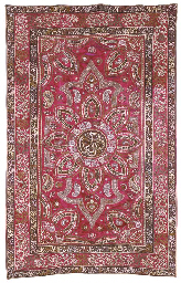AN OTTOMAN HANGING OR COVER