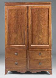 A mahogany and ebonised wardro