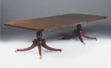 A mahogany twin pedstal dining