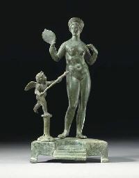 A ROMAN BRONZE GROUP OF VENUS