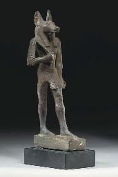 AN EGYPTIAN BRONZE ANUBIS