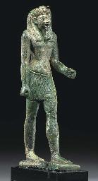AN EGYPTIAN BRONZE STRIDING MA