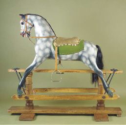 A late wooden rocking horse