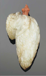 A Chinese mottled jade carved