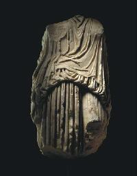 A ROMAN MARBLE DRAPED CARYATID
