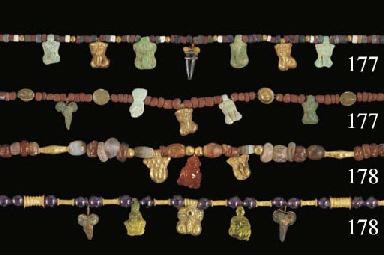 TWELVE ROMAN PHALLIC AMULETS