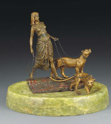 A patinated and enamelled bron