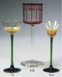 A RED AND CLEAR WINE GLASS