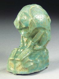 A seagreen glazed figure of a