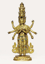 A GILT-BRONZE TANTRIC FIGURE O
