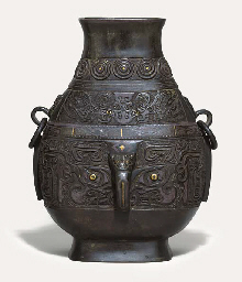 A SILVER AND GOLD-INLAID ARCHA