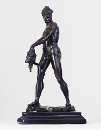 A BRONZE FIGURE OF AN EXECUTIO