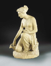 A CARVED MARBLE FIGURE OF THET