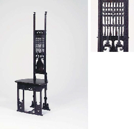 A CARVED OAK HALL CHAIR
