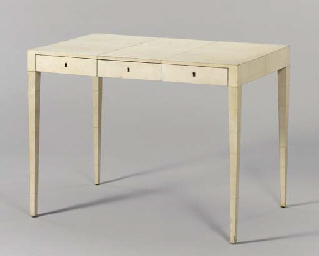 A PARCHMENT COVERED DESK