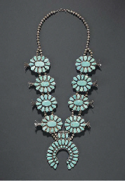 A NAVAJO SILVER AND TURQUOISE