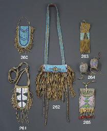 A BLACKFOOT BEADED AND FRINGED