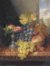 Still life with plums in a sil