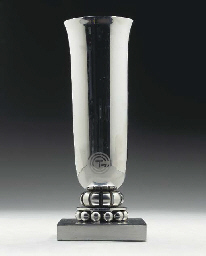 A chrome plated silver vase fo