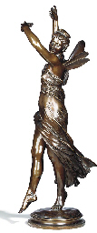 A FRENCH BRONZE FIGURE OF A WI