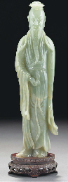 A large celadon jade figure of