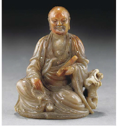A carved soapstone figure of t