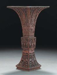 A cinnabar lacquer gu vase, 19