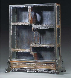 A carved hardwood and glazed d