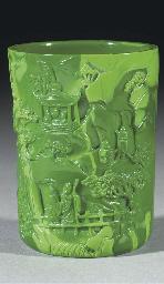 A mottled opaque green glass b