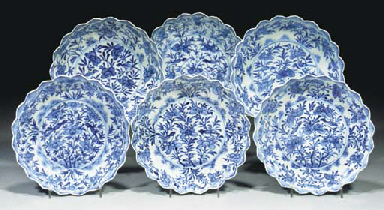 A set of six blue and white fl