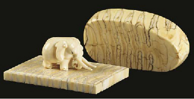 Two mammoth's tooth paperweigh