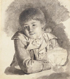 A seated boy holding a candle