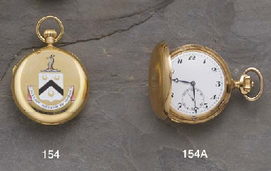A gold keyless Grande and Peti