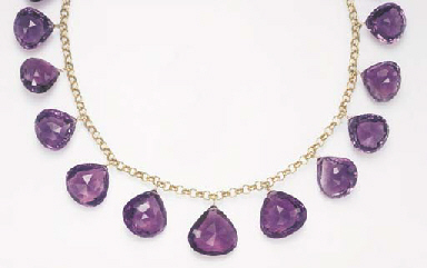 AN AMETHYST AND GOLD NECKLACE