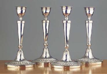 (4)  Four Dutch silver candles