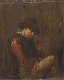 A man smoking a clay pipe