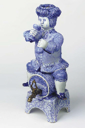 A Dutch Delft blue and white figural gin bottle or 'bobbejak'