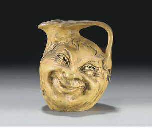 A Stoneware Double Faced Jug