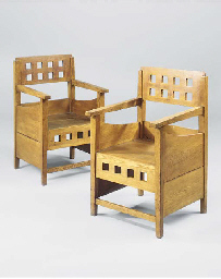 A PAIR OF OAK ARMCHAIRS