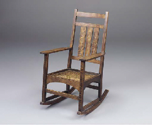 AN INLAID OAK ROCKING CHAIR