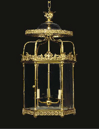 A GEORGE IV LACQUERED-BRASS HE