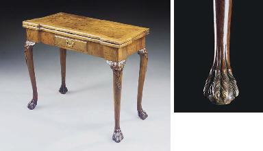 A GEORGE II WALNUT TEA-TABLE
