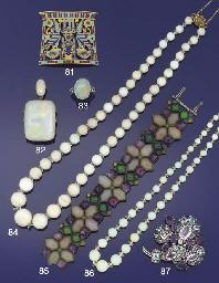 An opal bead, rock crystal and
