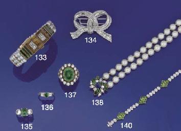 A cultured pearl, sapphire, em