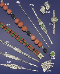 A coral, onyx and diamond brac