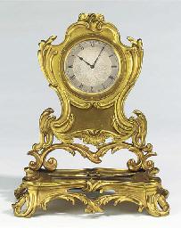 A Victorian brass desk timepie